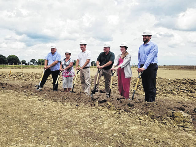 Bethany J. Royer-DeLong | Darke County Media A ceremonial groundbreaking was held for the new Village of Arcanum's administration and police headquarters on Tuesday afternoon at 309 Albright Street. Pictured left to right: Councilmembers Tim Philpot and Bonnie Millard, Arcanum Mayor Greg Baumle, Arcanum Village Administrator Bill Kessler, Hannah Holtzapple of Garmin/Miller, and Principal, Garmann/Miller Architects-Engineers Matt Hibner.
