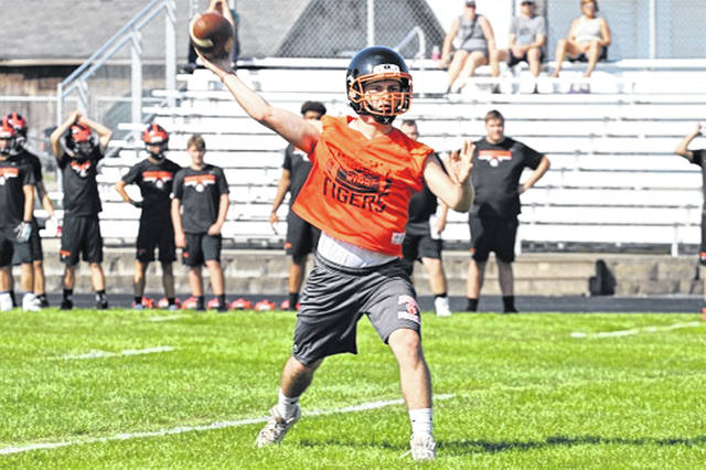 Ansonia returning starting quarterback, Hunter Buckingham throws a completion in the four-team Thursday scrimmage at Arcanum.
