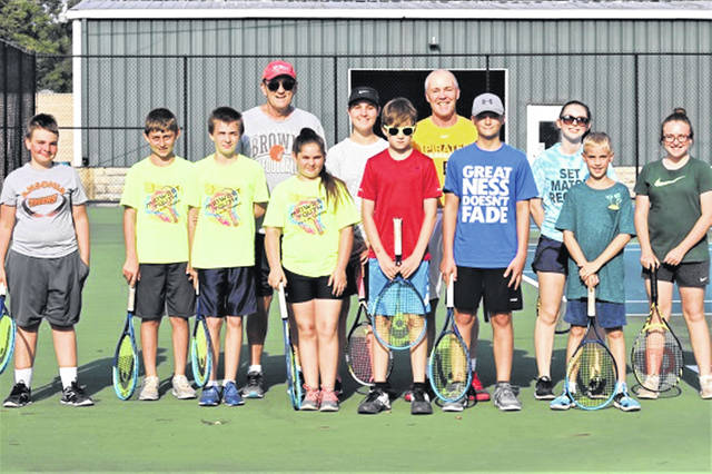 The Tuesday night Greenville boys and girls junior high tennis campers with coaches and high school assistants.