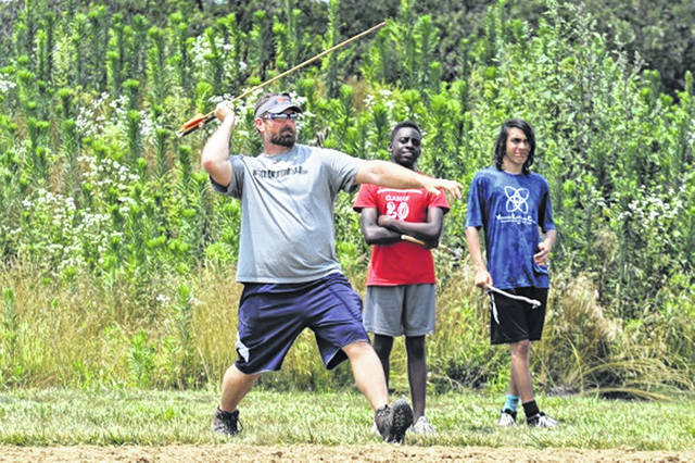 Campers look on as Matt Light makes a throw at the recent Light Foundation 10-day leadership camp.