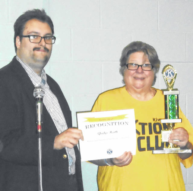 Aktion Club President Sam Ploch presented Gladys Heath with a certificate and traveling trophy for being the club's June Member of the Month.
