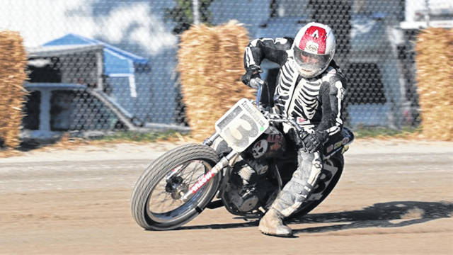 """Four time AMA Nationals Champion David Aldana rides his """"old bike"""" in the American Historical Racing Association (AHRA) race at the Great Darke County Fairgrounds."""