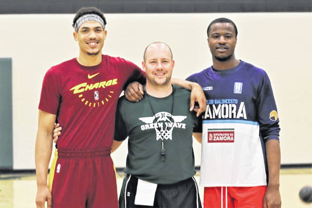 Former Akron University basketball players and Greenville varsity boys basketball coach Kyle Joseph at the recent boys basketball camp. (L-R) Aaron Jackson, Coach Kyle Joseph and Deji Ibitayo.