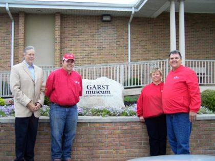 Pictured are Dr. Clay Johnson, president of Garst Museum, Jacob Furlong, and Pam and David Furlong, owners of Fitzwater Tree and Lawn Care.