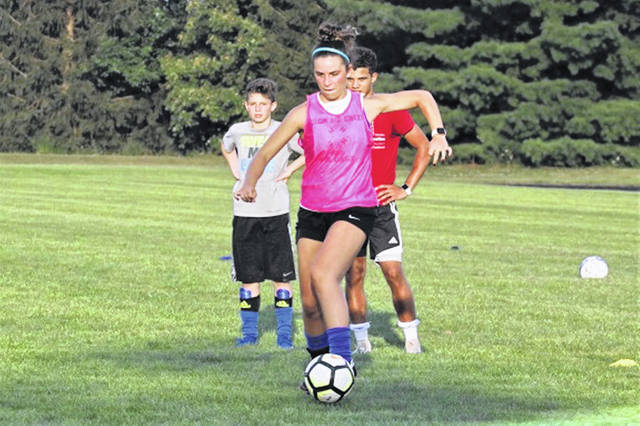 A Franklin Monroe Lady Jet moves the ball at the high school soccer camp.