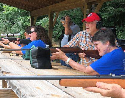Bruce Mikesell is shown instructing Katheleen Nealeigh after the beginner safety class. New this year is a shooting competition for experienced shooters.