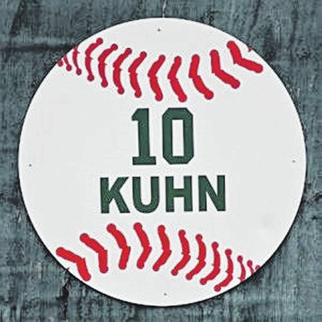 The retired No. 10 worn by Greenville's Tyler Kuhn hangs on the leftfield fence a Sater Heights Park, home of the Green Wave varsity high school baseball team.