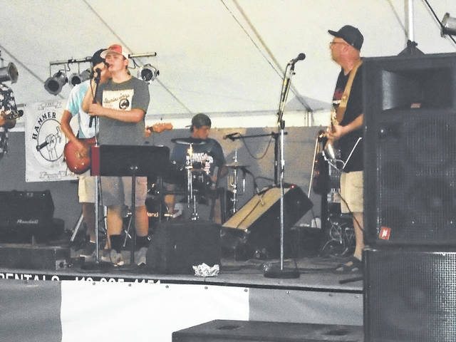 Steve Ruhenkamp, on the right, is shown performing with a group at the North Star Picnic Saturday night. The hot temperatures didn't keep many people away from the annual festival.