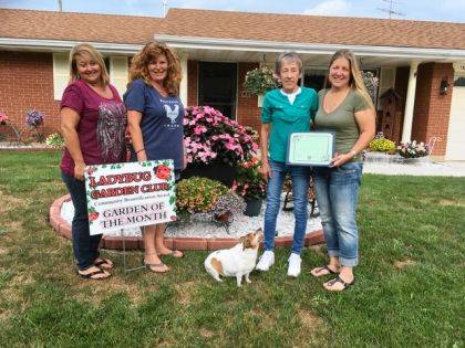 Shown presenting the award are Ladybug members Sherri Jones, Angela Beumer, her dog Maddie Marie, Robin and Ladybug Lisa Marcum.