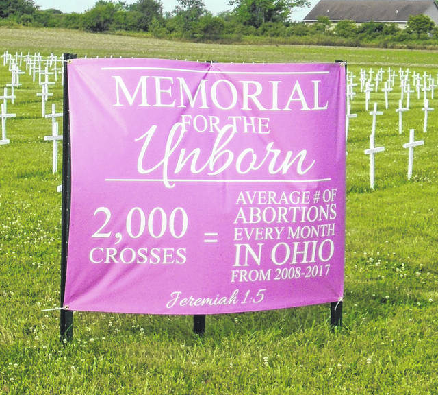 Above is one of the banners that have been placed with the 2,000 crosses representing the average monthly numbers of abortions in Ohio. The other banner is blue.