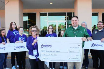 Greenville High School Principal Stan Hughes accepted a $1,000 check from Helen Jessup, store manager of Gordmans.