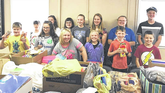 Members of the Blue Angels 4-H Club spent some volunteer and providing community service time this week helping count and sort back-to-school supplies donated during the recent United Way's Stuff the Bus collection. Stuff the Bus benefits children in the following school districts: Ansonia, Arcanum, Bradford, Franklin Monroe, Greenville, Mississinawa Valley, Tri Village, Versailles, and Board of Developmental Disabilities.