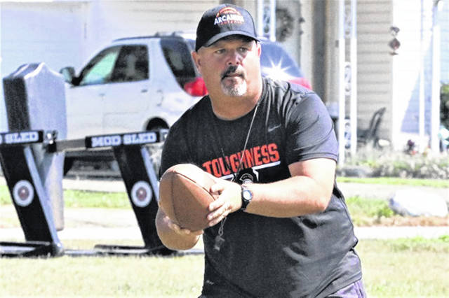 Arcanum head varsity football coach Jason Schondelmyer works out with his team in preperation of the new OHSAA season.