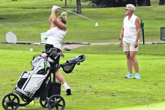 Lady Wave girls golf coach Tracy Haines observes her team's play at Turtle Creek.