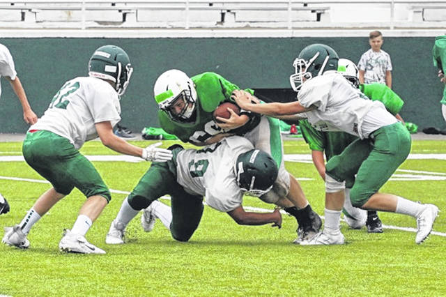 Greenville's defense stops Celina for no gain in the Tuesday morning scrimmage at Harmon Field.