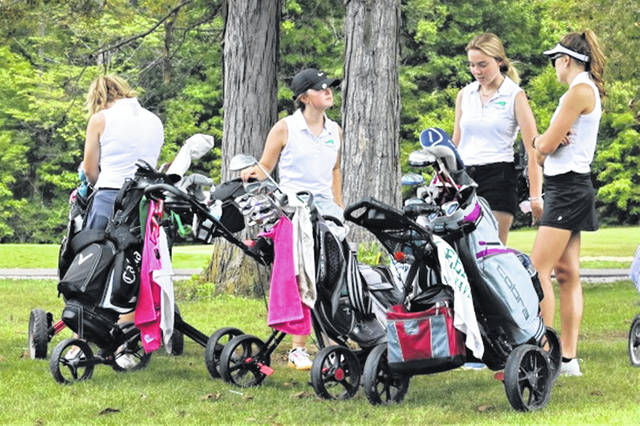 The Greenville Lady Wave golf team waits to tee off.