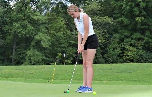 Jessica Mortensen lines up for a put at Turtle Creek in the Lady Wave's win over the Piqua Lady Indians golf team.