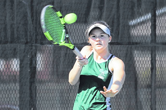 Greenville's Natalie Milligan returns a serve against her St. Mary's opponent to win her second singles match in the Lady Wave's season opening win over the visiting Lady Roughriders.