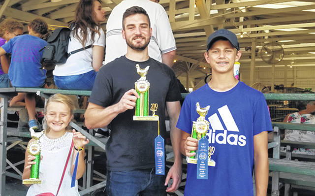 Bethany J. Royer-DeLong | Darke County Media The first-place winners of the human rooster crowing contest (from left to right) for ages three to eight Channing Powell, ages sixteen to adult first place Landon Bundenthal, and first place for ages nine to fifteen Gage Lochard.