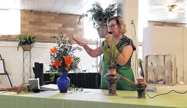 Bethany J. Royer-DeLong | Darke County Media Ladybug Garden Club Vice President Irma Heiser gave a how-to presentation on artistic and traditional designs for Garden Highlights held at the coliseum during the 163rd Great Darke County Fair on Sunday.