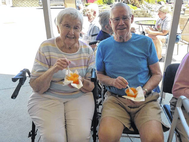 Courtesy photo Margaret and Lou Fiely enjoy snow cones during the Brethren Retirement Community Fair Day on Friday, Aug. 9. Fair Day provides BRC residents with an opportunity to enjoy fair-related activities right in their own backyard.