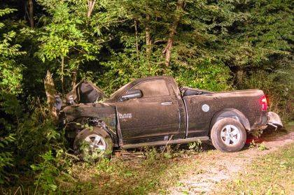 The driver of this truck is believed to have gone airborne before striking a tree head-on.