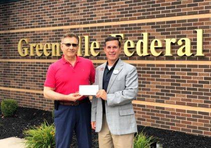 Sam Casalano, left, CEO of the YMCA of Darke County, accepts a donation from Jeff Kniese, president and CEO of Greenville Federal, toward the YMCA's 2019 Annual Community Partners Campaign.
