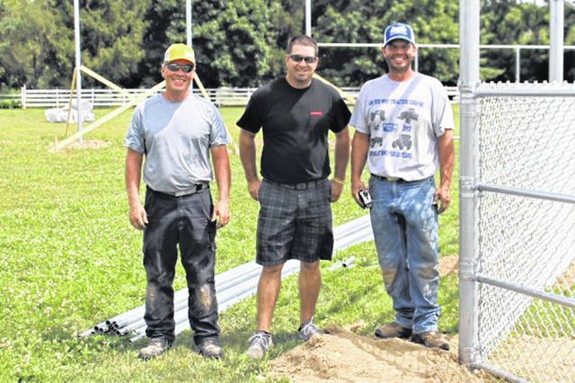 (L-R) Jeff Dohme, Eric Fellers (GGSA President) and Josh Dohme (owner) of JD Fence of Greenville work on the new diamonds at Stebbins Field in Greenville.