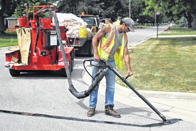 Former GHS athlete Peter Pandy works with the City's street department before retuning to the University of Cincinnati for fall classes.