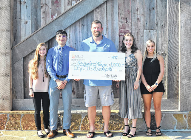 Local graduates receiving the Light Foundation Scholarships, included from left to right, FM graduates Nicole Brocious and Ting Hao Zheng, with Matt Light and Greenville graduates Rachel Unger and Ashley Jolley.