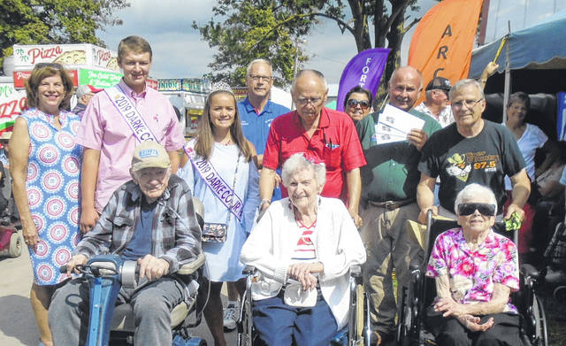The oldest fair-goers on Monday at the Great Darke County Fair were, seated from left, Herman Kolb, Mildred Dill and Lucille Thomas, all who are 105 years of age; and back row from left to right, Amy Erisman, 2019 Fair King Jacob Wuebker, 2019 Fair Queen Tory Wuebker, Fair Board Director Ed Erisman, Jim Short, Jennifer and Greg Peck of Greg Peck Sound System and Bill Frankman, Thomas' son.