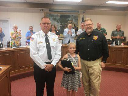 Sophia Stoner was honored during a recent Greenville City Council meeting for saving her family during a fire in April. She was joined by Chief Russ Thompson and State Fire Marshal Asst. Chief Richard Palmer.