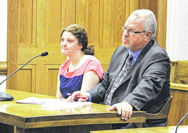 Darke County Media Shaela Thompson is pictured with defense attorney Dave Rohrer while giving a guilty plea to two drug felonies in Darke County Common Pleas Court in 2017. She went before Judge Hein for non-compliance to terms of community control sanctions from those charges in court Monday.