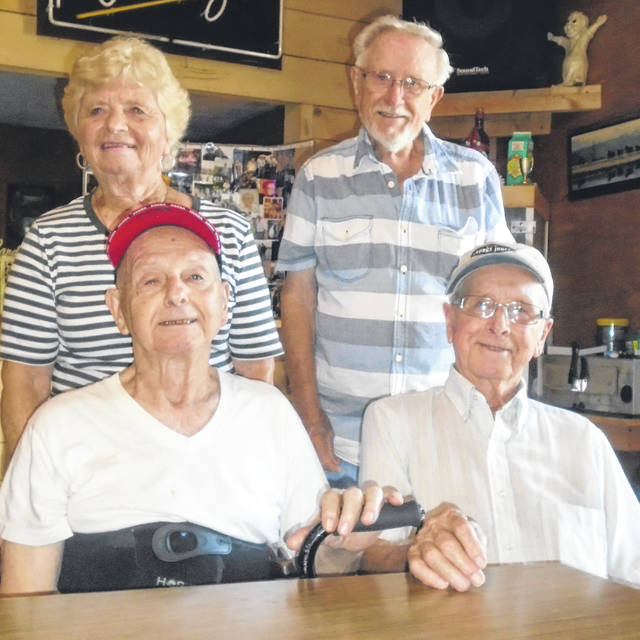 Carl Francis, seated right, was honored Saturday at a surprise 90th birthday party. He is shown with his siblings who showed up: Tom, also seated; and standing, sister Mary Brush and brother Ed. There were 11 chilren in the family, eight of whom were boys, who all ended up serving in the military at one time or another.