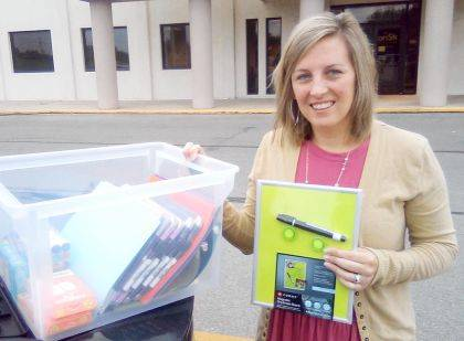 Ashley Kozak, BASF Corporation, dropped off supplies donated by employees to help in Empowering After School Tutoring Programs.