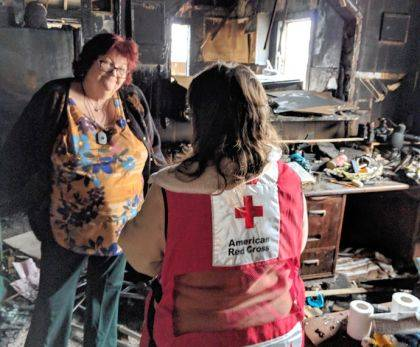 Pictured is a Red Cross volunteer meeting with a fire client immediately after the fire in their home.