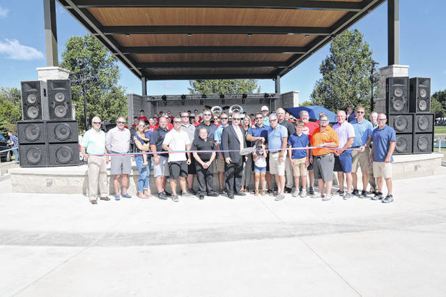 The new Heritage Park Amphitheater was officially open with a ribbon cutting during the Sept. 14 Versailles Bicentennial Celebration. Pictured are members of YOLO, the Heritage Park Board of Directors, project funders and State Auditor Keith Faber, who assisted with a grant to help fund the facility.