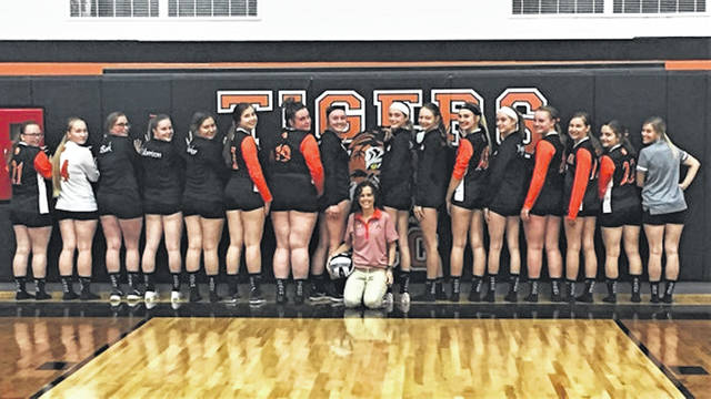 """The 2019 Ansonia Lady Tigers show their """"Coach Strong"""" sox. (Coach Darcy Buckingham front/center)."""