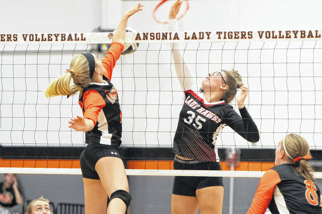 The Mississinawa Valley Lady Blackhawks and the Ansonia Lady Tigers square off in volleyball play.