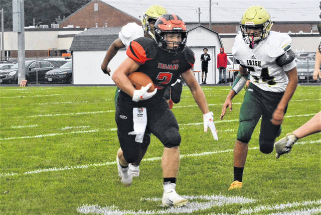 Cory Ross carries the ball for Arcanum in big win over Central Catholic.