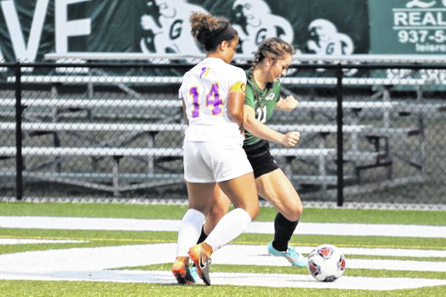 Lady Wave senior, Eliza Wysong battle for control in varsity soccer match with the Vandalia-Butler Lady Aviators.