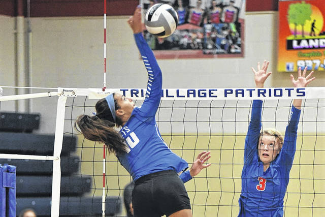 Corina Conley goes for a kill for the Lady Jets in win over the Tri-Village Lady Patriots.