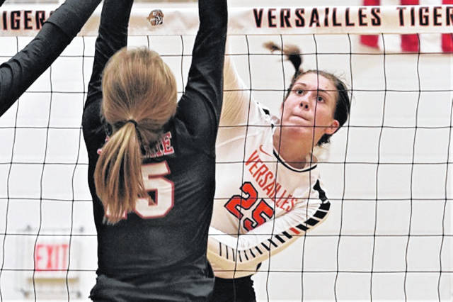 Lindsey Winner gets a kill for Versailles in Saturday's home match with the Fort Loramie Lady Redskins.