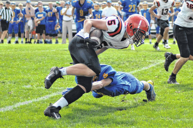 Michael Stammen picks up yards for the Versailles Tigers in Saturday's win over Delphos St. John's.