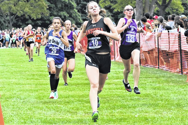 Ansonia's Olivia Wright crosses the finish line for the Lady Tigers at the Greenville Treaty City Invitational.