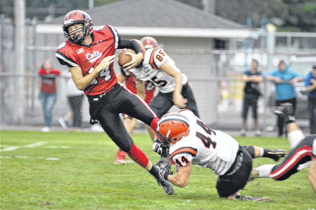 Jared Seibert makes a tackle for Versailles in 48-0 win over Delphos Jefferson.