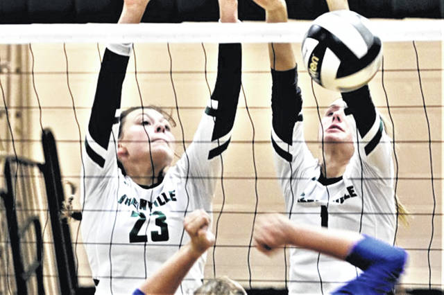 Abbie Yoder (L) and Emma Klosterman (R) go to the next for the Lady Wave.