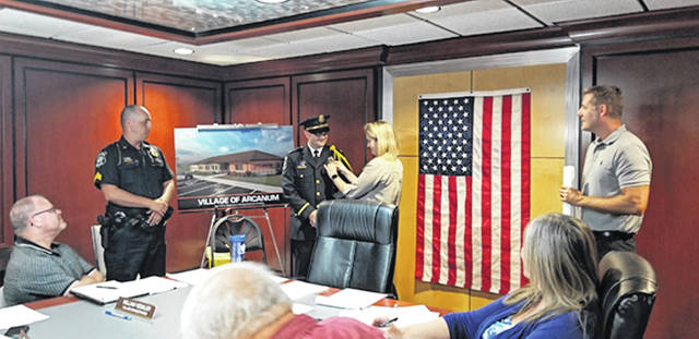 Bethany J. Royer-DeLong | Darke County Media A swearing-in ceremony was held for new police Chief Marcus Ballinger during Tuesday's council meeting. Chief Ballinger was joined by his wife, Erin, Sergeant Tim Zellers, and Mayor Greg Baumle.