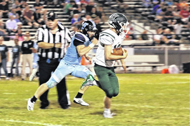 Greenville quarterback Tyler Beyke scampers for 31-yards in a Wave second half 10-play TD drive.