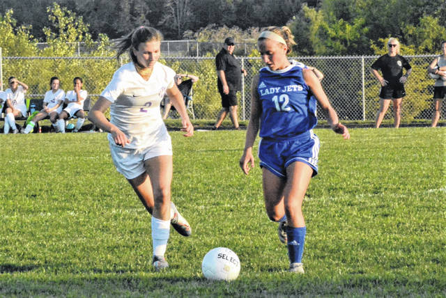 Chloe Brumbaugh moves the ball for the Franklin Monroe Lady Jets in soccer match with Dayton Christian.